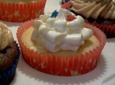 White Chocolate Cheesecake Filled Vanilla Cupcakes with Cream Cheese Frosting