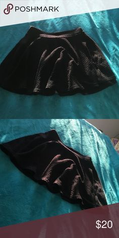black short skirt super cute and stylish black skirt. 98% polyester and 2% spandex. really soft, flowy, and comfortable. It's an XL in girls, but could fit a women's XS. Bottoms Skirts