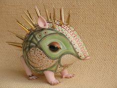 Green hedgehog with blades of grass. Soft porcelain. by Anya Stasenko and Slava Leontyev