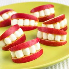 (link leads to article - not how-to)  Simple treat for Halloween though.  Apple slices with Peanut Butter on either side, mini marshmallows and BOOM, you got a mouf.  Smile it up, this is cute!