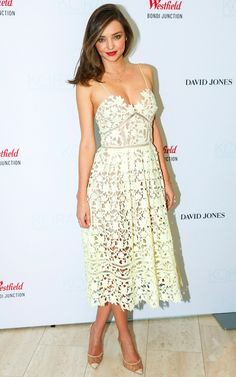 Miranda Kerr in an off-white lace Self Portrait dress