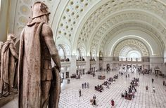 Washington, D.C.'s Union Station, after restoration --  A row of Roman centurion statues overlooks the bustling Main Hall. -- Architectural Digest -- 7-21-16