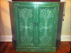estate sale nook cabinet distressed with hand-painted raised carvings