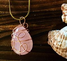 A personal favorite from my Etsy shop https://www.etsy.com/listing/254078507/gold-wrapped-teardrop-shaped-rose-quartz