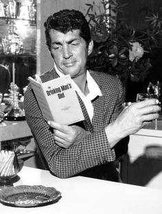 "REMINDS ME OF MY GRANDFATHER...Dean Martin studies ""The Drinking Man's Diet""  C. 1960s"
