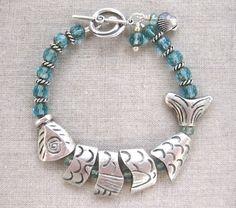 Turquoise Fish coastal bracelet w silver segmented fish & Czech glass by SeaSideStrands