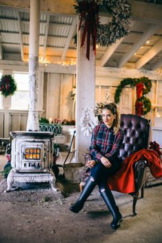 Gal Meets Glam A Very Merry Holiday Prep wearing J.Crew plaid shirt, jeans and coat, and Hunter boots