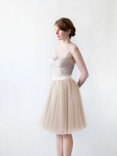 Our Gretta Tulle Skirt is made with 6 layers of tulle layered to create the perfect shape.  This skirt is fully lined with a center back invisible zipper.  The silk taffeta waistband is non-stretch and has a hook and eye closure.