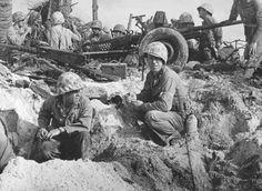 Weary US Marines taking a cigarette break, Namur, Kwajalein, Marshall Islands, early Feb 1944; note 37mm anti-tank gun and Browning M2 machine gun