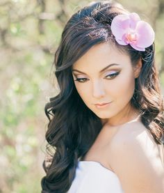 Bridal hair/makeup inspiration. Love that orchid in her hair.