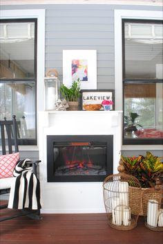 A built-in electric fireplace provides warmth this screened in porch styled by Jennifer Bridgman of The Chronicles of Home. See more of this three-season porch on The Home Depot Blog. || @chrniclesofhome