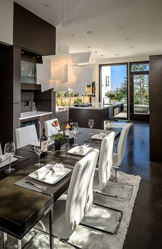 Modern dining room/ kitchen concept: dark wood & white leather