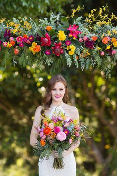 Modern pink, orange and yellow wedding ceremony flowers with bright rainbow bouquet | Lyndal Carmichael Photography