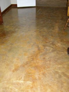 I stained our basement floor using a plant mineral called copperas. Mopped on about 8 coats and then sealed it with concrete sealer. The whole basement cost about $150 ( 1800 sq. ft.)