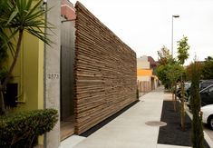 """Wooded walls (sandblasted """"driftwood"""" feeling) adding warmth, windscreens and texture to exterior halls, decks, facade. Exterior Design, Interior And Exterior, Wall Exterior, Stone Exterior, Modern Exterior, Outdoor Spaces, Outdoor Living, Landscape Design, Garden Design"""