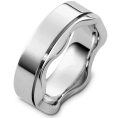 18 Kt White gold wedding band, 7.0 mm wide, comfort fit wedding band. The ring is polished. Different finishes may be selected or specified.