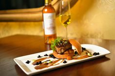Pan Seared Foie Gras brioche 'slider' roasted peaches, toasted pistachios, huckleberry-port glaze, & natural jus