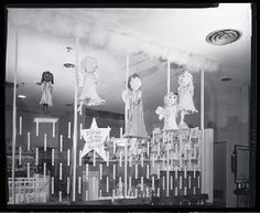 """""""Santa we were very good!"""" sign in a Stix, Baer, and Fuller Christmas display, probably at Westroads Shopping Center at the corner of Brentwood road and Clayton Road. Photograph by Henry T. (Mac) Mizuki, Nov. 27, 1955. Mac Mizuki Photography Studio Collection, Missouri History Museum. 