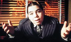 Th slightly further set apart stripe we have come to associate with gangster movies and the mob .  John Cassisi as Fat Sam (Bugsy Malone, 1976)