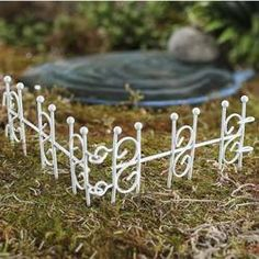 Fairy Garden Micro Miniature 1 3/4 inch tall white, metal decorative garden fence. With a choice of a 9, 18, or 36 length so that you will have just enough of fencing to border around your fabulous fairy hut, line your adorable miniature fairy vegetable garden to keep the deer out (of course ;) ) or to stand alone as accents in your outdoor fairy gardens and floral arrangements. Since this item is micro miniature it would also be perfect for very small terrariums and small potted living…