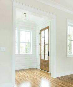 Shiplap walls with warm wood door