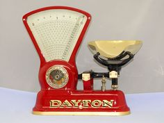 American antique fan scale in red with brass pan and castings, Model 166 by the Computing Scale Co of Dayton, OH, circa 1910.