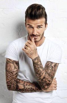 White t shirt. Tattoos.