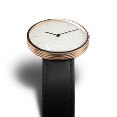 The Circles Club by MMT has a rose gold case, domed glass lens and a black leather strap. #watches #design