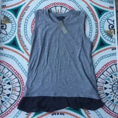 Brand new! Gray and black tank! Still has the tags. This soft tank would be a great addition for anyone's closet! Silky looking ruffles at the bottom. J. Crew Tops Tank Tops