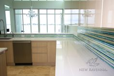 This custom kitchen backsplash features Random Stripes, a handmade  mosaic, shown in Peacock Topaz, Turquoise, Aquamarine, Peridot and Opal jewel glass.<br /> -photo courtesy of Tile Market of Sarasota, LLC<br /> <br /> For pricing samples and design help, click here: http://www.newravenna.com/showrooms/