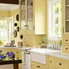 6 Colorful Kitchens We Love  pic #2 Sherwin Williams Convivial Yellow. Would prefer this with simple white knobs on the cabinets. This looks a little busy to me.