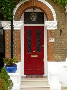 A red door gives a home real kerb appeal.