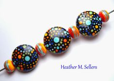 """""""Mod Dots' a set of unique lampwork glass beads by Heather Sellers."""