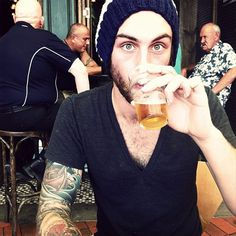 sir... i don't know who you are, but i like everything you've got going on.  the v-neck, the beanie, the tats, the beer, the eyes... come here to me.