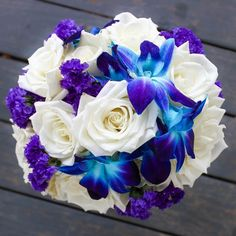 For the bridesmaids matching round bouquets of roses dendrobium orchids and statice!  #thefloralcottageflorist #bridesmaidbouquet #louisianaweddings #bridetobe #bluedendrobium #ivoryroses