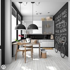 This black-and-white kitchen is a hipster's heaven. Black dome lighting over a wooden table and chair sit beside a chalkboard wall, bike, and opaque cabinet doors.