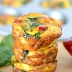 Spinach and Red Pepper Mini Frittatas Recipe Breakfast and Brunch with olive oil, diced onions, red bell pepper, spinach, large eggs, milk, shredded sharp cheddar cheese, salt, pepper