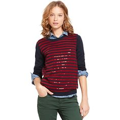 Tommy Hilfiger women's sequin sweater. Sequin adorned stripes give our crewneck pullover sweater a little something extra. • Slim fit.• 100% merino wool.• Fine lightweight knit, sewn sequin detail, solid arms and back.• Hand wash.• Imported.