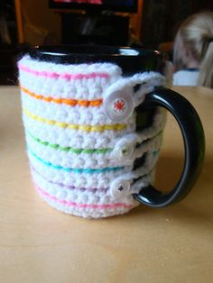 This pattern has been tested. Pattern for a right and left hand mug cozy. Please use a correct hook to obtain the gauge. I used an acrylic 5.0mm (H) hook when I designed the pattern. When I made a cozy with a steel (H) hook the gauge was a lot tighter. If using a metal hook, try using an (I) hook.