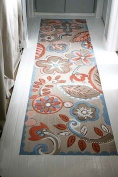 Nice twist on a painted floor -- a painted floor runner. I'd love this on my concrete patio! I might have to look into this.:
