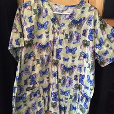 Butterfly scrub top Great for spring time. Butterfly pattern scrub top. Tones of purple pink and blue. Gently used Tops