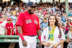 Ortiz and the Olympian:    Olympic gymnast Aly Raisman poses with David Ortiz of the Boston Red Sox before throwing out a ceremonial first pitch before the game against the Kansas City Royals at Fenway Park in Boston on Aug. 26.