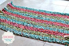Braided rug sewn to a piece of heavy fabric.