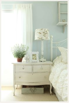 It is time to paint some bedside tables!! Pretty blue and white bedroom.