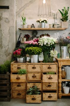 Love how this image marries furniture with flowers - a great idea for a little spot in a florist's space