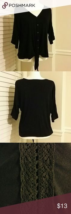Style & Co. Top Cute top that has 4 buttons down the front.  Ties at the waist.  Sleeves are half length and have a lace looking train down the sleeve.  95% rayon, 5% spandex Style & Co Tops