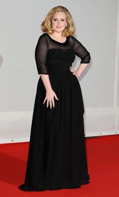 At the 2012 Brit Awards Red Carpet look, February 2012. Gown by Burberrry.