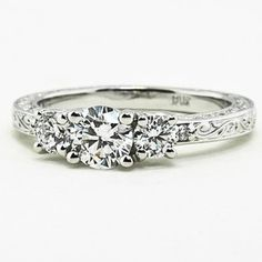 Similar to my engagement ring... (Antique Scroll Three Stone Trellis Ring by Brilliant Earth conflict free diamonds)