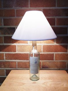 Items similar to Upcycled Wine Bottle Table Lamp on Etsy A Table, Table Lamps, Brass Lamp, Light Bulb, Wine, Bottle, Home Decor, Etsy, Products
