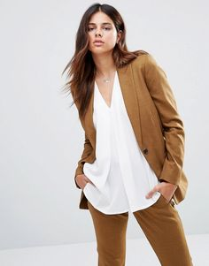 Buy it now. Selected Domi Blazer - Brown. Jacket by Selected, Textured woven fabric, Peak lapels, Single button fastening, Buttoned cuffs, Functional pockets, Relaxed fit, Dry clean, 39% Polyester, 30% Wool, 28% Viscose, 3% Elastane, Our model wears a UK 8/EU 36/US 4 and is 173cm/5'8 tall. ABOUT SELECTED Embracing freedom, identity and style, Selected offers a collection of understated elegance and timeless cool. Focusing on clean, contemporary lines with its tailoring, Selected creates a…